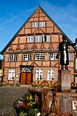 Fountain in front of half timbered house