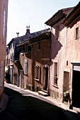 View of narrow street and old small houses