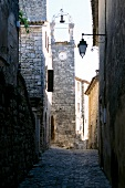 Alleyway and church tower made of stones