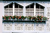 Carved windows on houses and flowers, Switzerland