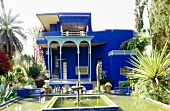 View of Yves Saint-Laurent's blue house with garden and fountain