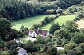 View of large country house on green landscape in Southwest Ireland