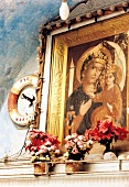 Photo frame of Madonna with child on wall