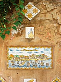 Mediterranean hotel wall with antique hand painted images on wall tiles