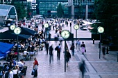 People walking at Nash Court, Docklands, London, England, blurred motion