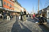 People at Nyhavn Canal in Copenhagen, Denmark