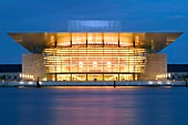 View of illuminated Royal Opera at night in Copenhagen, Denmark