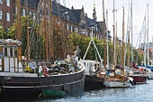 Sail boats moored at harbour in Christianshavn, Copenhagen, Denmark