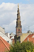 View of Church of Our Saviour between rooftops in Christianshavn, Copenhagen, Denmark