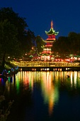 View of illuminated Chinese Pagoda in Tivoli Gardens at night, Copenhagen, Denmark