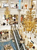 Interior of Illum shopping mall with escalator and chandeliers