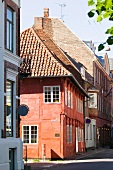 View of red tudor style house on street in Helsingor, Denmark