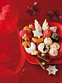 Various Christmas biscuits on a red plate