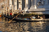 People travelling in Gondola at Grand Canal in Venice, Italy