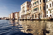 Facade of white buildings on Grand Canal in Venice, Italy