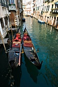 Two empty gondolas moored in Grand canal, Venice, Italy