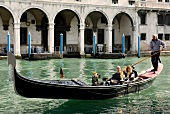 Tourists enjoying gondola ride in Grand Canal, Venice, Italy