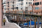 Gondolas moored in Misericordia Canal, Venice, Italy