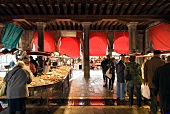 View of people shopping at market stalls at Rialto bridge, Venice, Italy