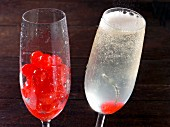 A glass of red currants and a glass of French 75