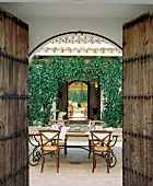 Patio of a house with opened door in Andalusia, Spain