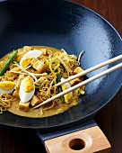 Stir-fired noodle curry with tofu and egg (Indonesia)