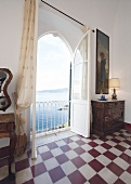 View of window and checked tiled floor in Hotel Castello Canevaro at Cinque Terre, Italy