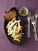 Marinated teltow turnips with chopped almonds and vanilla served with bread