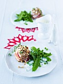 Pork medallions with a bacon and nut crust served with mange tout with sour creams sauce