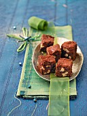 Chocolate brownies with walnuts on serving dish