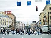 People walking on zebra crossing in Nevsky Prospekt street, St. Petersburg, Russia
