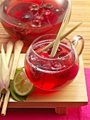 Singapore sling punch with gin, sweet cherries and lemongrass