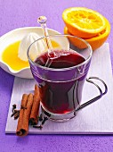 Mulled wine with cinnamon sticks, cloves and orange juice