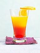 Tequila Winter Sun mit Orangenscheibe am Glasrand