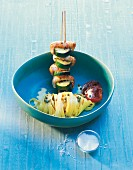 A prawn skewer with courgettes and saffron noodles