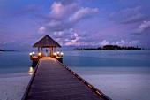 View of gazebo on jetty at sunset in Dhigufinolhu island, Maldives