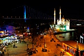 Illuminated Mecidiye mosque with waterfront at night, Bosphorus, Turkey