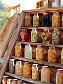 Different sweet fruits in jars on wooden shelf, Pelion Mountain, Eastern Magnesia, Greece