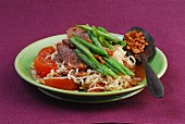 Stir-fried wheat noodles with duck, beans and tomatoes