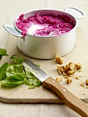 Beetroot sauce with walnuts and basil being made