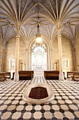 Interiors of The Neogothic chapel with chandelier and benches in Mosovce, Slovakia