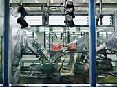 Robots painting a car in production line, BMW World, Munich, Germany