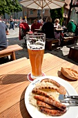 Sausage with bratwurst, sauerkraut and wheat beer on plate, Regensburg