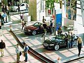People at car exhibition in Munich, Germany, elevated view