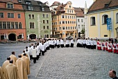 Members of the choir group entering the Regensburg Cathedral Choir to attend concert