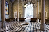 Interiors of The Neogothic chapelwith chandelier and benches inMosovce,Slovakia