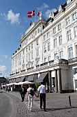 Facade of Hotel D'Angleterre and people walking, Copenhagen, Denmark
