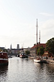 Boats and building near canal in Copenhagen, Denmark