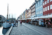 View of people and houses at Nyhavn in Copenhagen, Denmark
