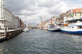 View of boats and houses in Nyhavn, Copenhagen, Denmark